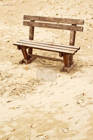 Photo for Empty wooden bench on the beach in cloudy weather. Concept of loneliness, emptiness, solitude. - Royalty Free Image