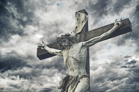 Photo for Crucifixion. Christian cross with Jesus Christ statue over stormy clouds. religion and spirituality concept. - Royalty Free Image