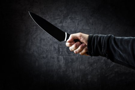 Photo for Evil man with shiny knife - a killer person with sharp knife about to commit a homicide, murder scenery. - Royalty Free Image