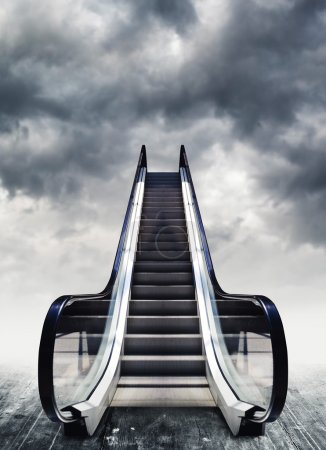 Escalators, conceptual image. Moving stairway to h...