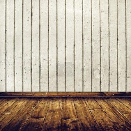 Photo pour Vintage intérieur de la chambre avec mur de briques de béton blanc et plancher en bois comme fond pour le placement de produits - image libre de droit