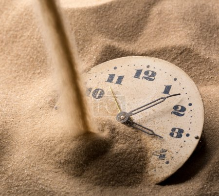 Photo for Sand pouring on old clock face - Royalty Free Image