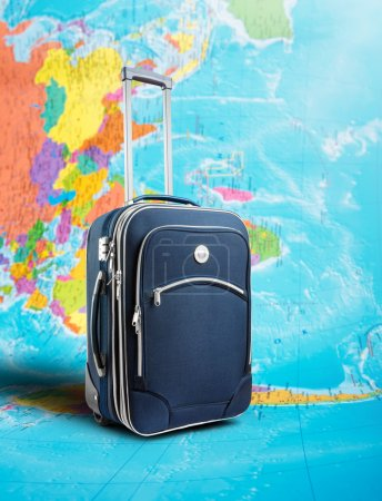Photo for Journey suitcase standing on the map - Royalty Free Image