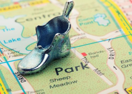 Road map with statuette shoe
