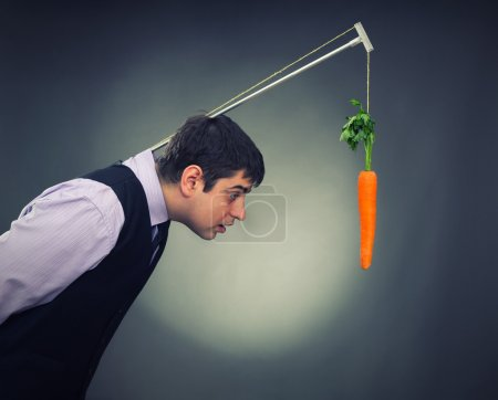 Man and carrot-bait studio shot...