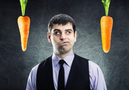 Two carrots and businessman