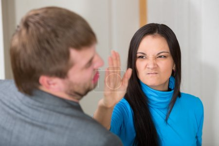 Woman about to slap her partner