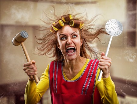 Photo for Crazy housewife with hammer on her hand - Royalty Free Image