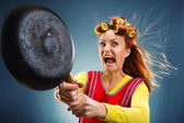 Crazy housewife with pan