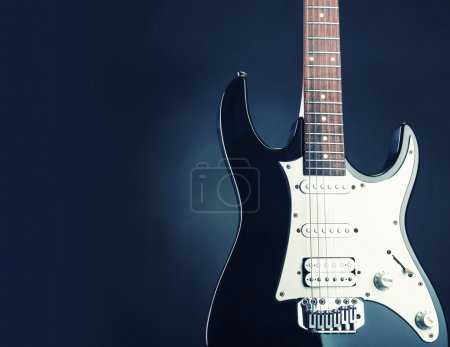 Photo for Modern electric guitar. Toned in blue - Royalty Free Image