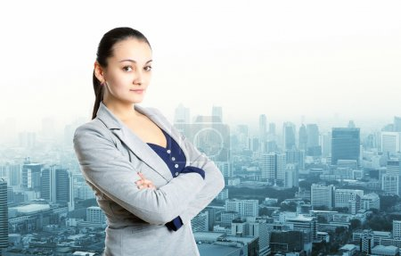 Photo for Pretty young woman over city view - Royalty Free Image