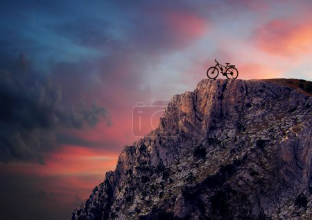 Photo for Silhouette of a mountain bike in mountains at sunset - Royalty Free Image