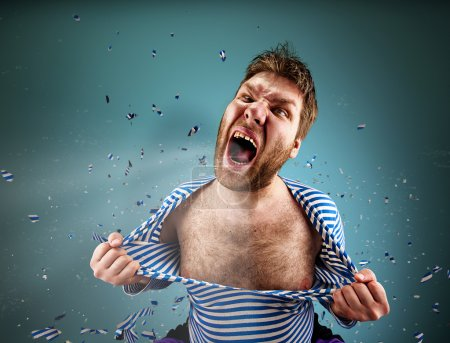 Photo for Furious man is tearing clothing on himself and are screaming - Royalty Free Image