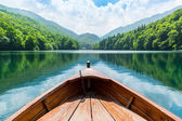 Wooden boat on lake