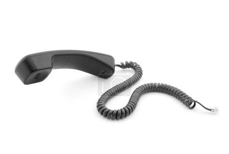 Photo pour Combiné téléphone noir avec ombre douce sur blanc - image libre de droit