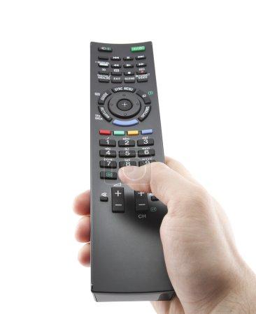Photo pour Appuyez à la main sur la télécommande avec le chemin de coupe - image libre de droit