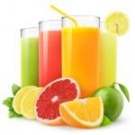 Fresh citrus juices isolated on white...