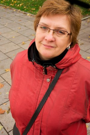Portrait of a middle-aged woman in a red jacket...