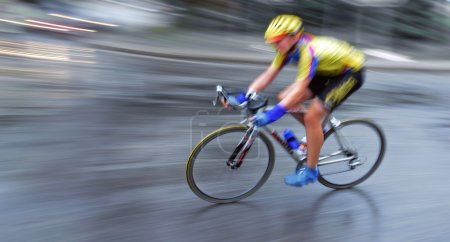 Speedy bicyclist in motion