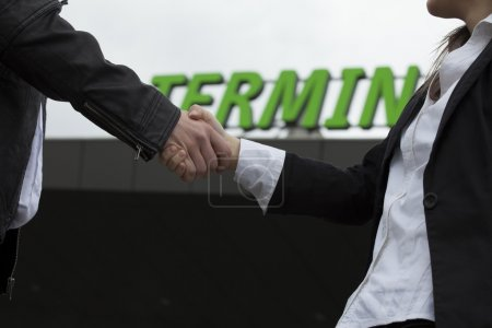 Handshake in front of terminal