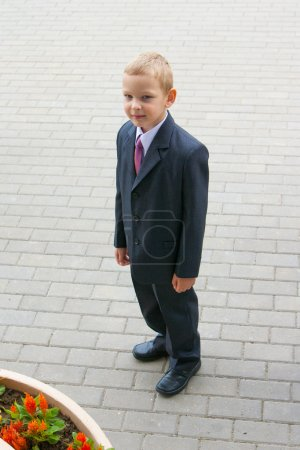 Cute young boy in suit