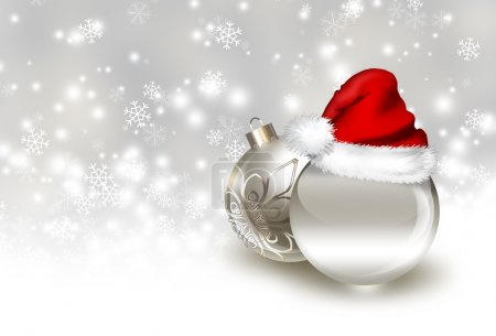 Photo for Silver christmas balls with Santa hat on a background of falling snow - Royalty Free Image