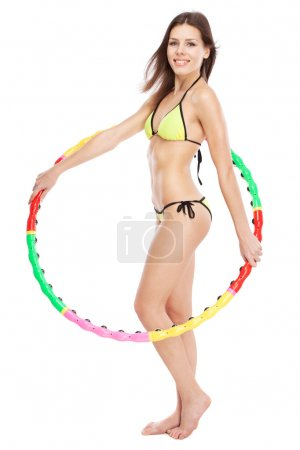 Beautiful slim woman with hoola hoop