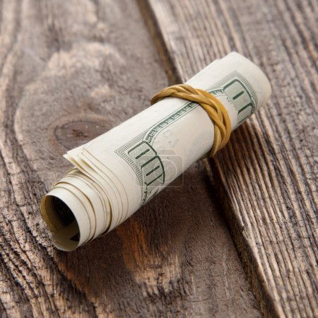 Photo for Dollar bills on a wooden table - Royalty Free Image