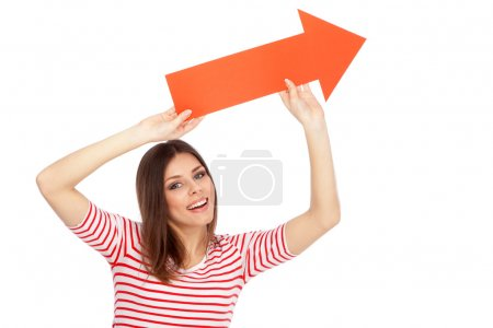 Photo for Young casual woman showing a direction with a red arrow - Royalty Free Image