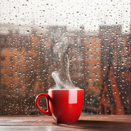 Photo for Steaming coffee cup on a rainy day window background - Royalty Free Image