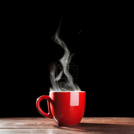 Photo for Steaming coffee cup on dark background - Royalty Free Image