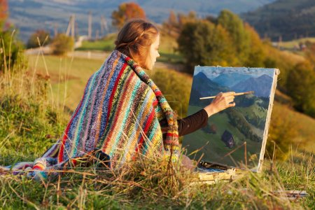Photo for Young artist painting an autumn landscape - Royalty Free Image