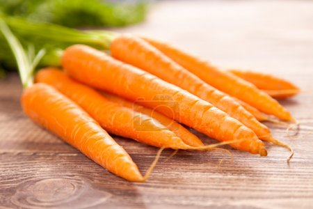 Photo for Carrot on a wooden table - Royalty Free Image