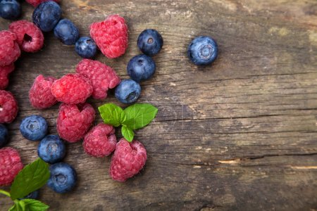 Photo for Fresh berries on a wooden table - Royalty Free Image