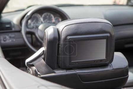 Multimedia screen in a luxury car