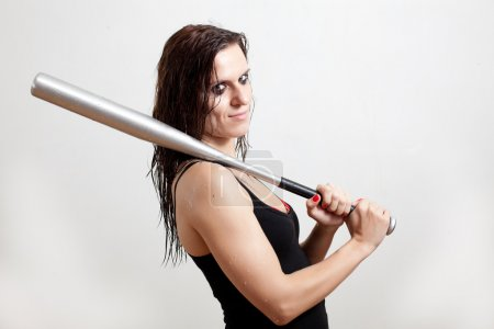 The wet woman the hooligan holds baseball bat on a...
