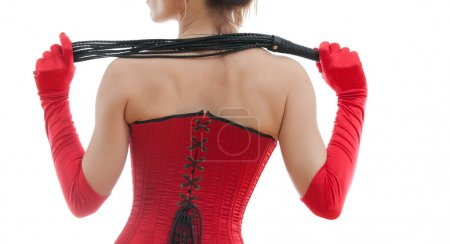 Photo for Woman in a red corset and whip on white background - Royalty Free Image