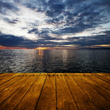 Platform beside sea with sunset