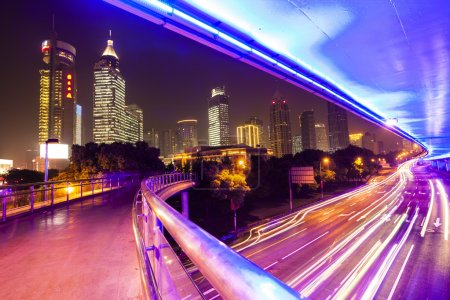 Photo for Moving car with blur light through city at night - Royalty Free Image