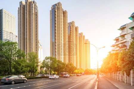 Photo for Empty street in modern city with sunset - Royalty Free Image