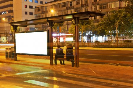 billboard in the station at night