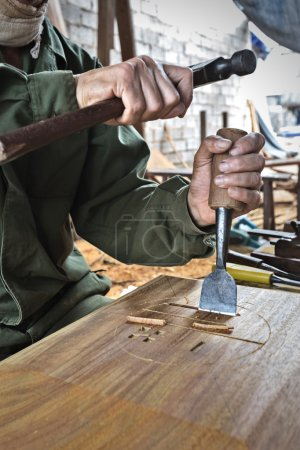 Worker carving wood
