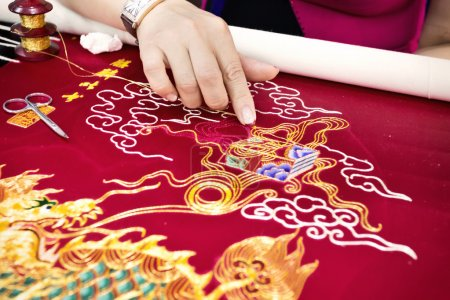 Hands embroidered dragon