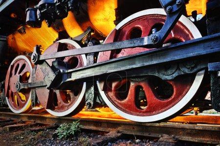 The steam locomotive wheels close-up