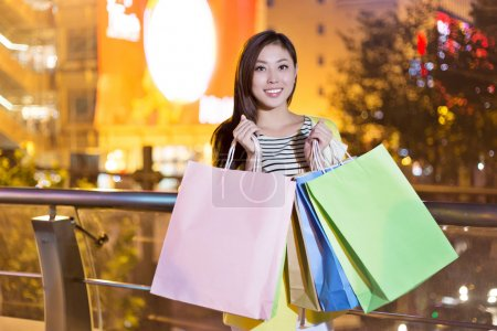 Photo for Happy woman shopping and holding bags girl - Royalty Free Image