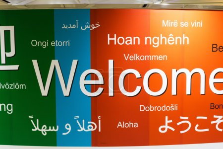 various languages of welcome in a wall