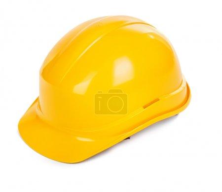 Photo pour Chapeau dur jaune sur fond blanc, petite ombre naturelle sous l'objet - image libre de droit