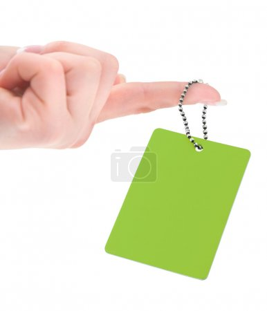 Female hand holding empty price tag