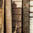 A close up of many old books...