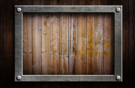 Photo for A metal frame on a wooden background - Royalty Free Image